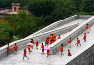 A group of Korean children happily moving down a ramp at the National Museum of Korea in Seoul.