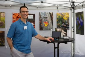 Dan Greenberg in his booth at Art on the Square in Williamsburg, VA.