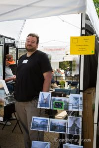 Geoffrey Coleman in his booth at Art on the Square in Williamsburg, VA.