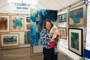 Laura Gibbs with her dog, Penny, at Art on the Square in Williamsburg, VA.