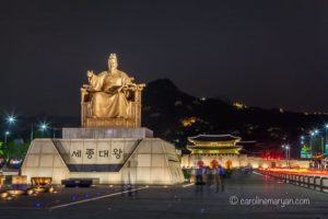 A 25 second exposure of the statue of King Sejong in Seoul, South Korea. In the background, Gwanghwamun Gate can be seen.