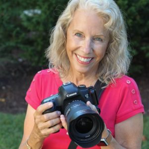 Caroline Maryan holding her Canon camera.