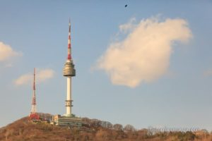 A spring photo of Seoul Tower, in Seoul, South Korea. The black line on the top is dirt on my camera sensor.