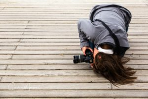 My friend, Laura, capturing a low shot on the Boardwalk in Deauville, France.