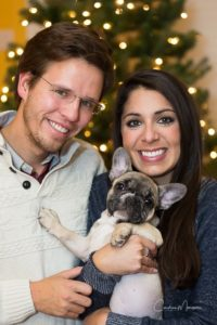 Napoleon, the French Bulldog, poses with his family at Christmas time.