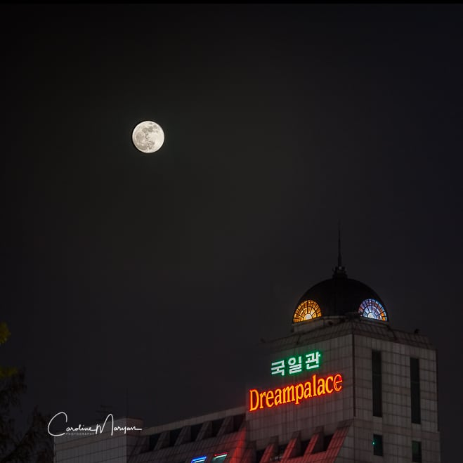The perigee super moon shown rising above the Dreampalace building in Seoul, South Korea on May 5th, 2012