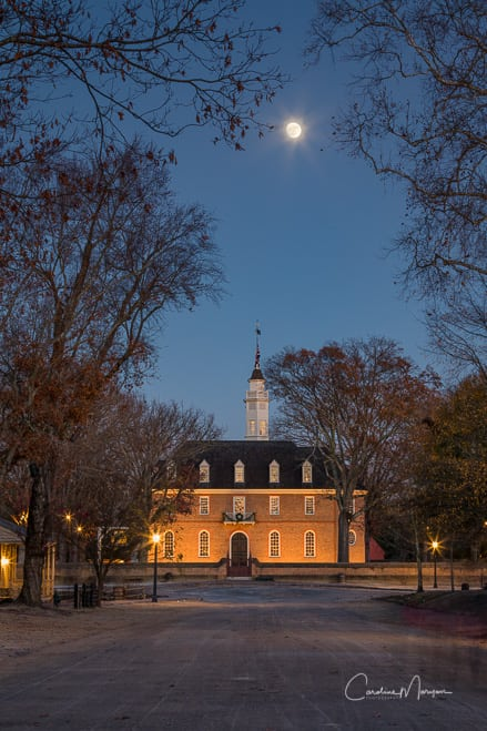 Capitol building in Colonial Williamsburg under a full moon