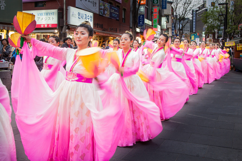 A travel photographer would use this photo of Lotus Dancers to help tell the story of the celebration of Buddha's Birthday in Insadong, Seoul, South Korea.