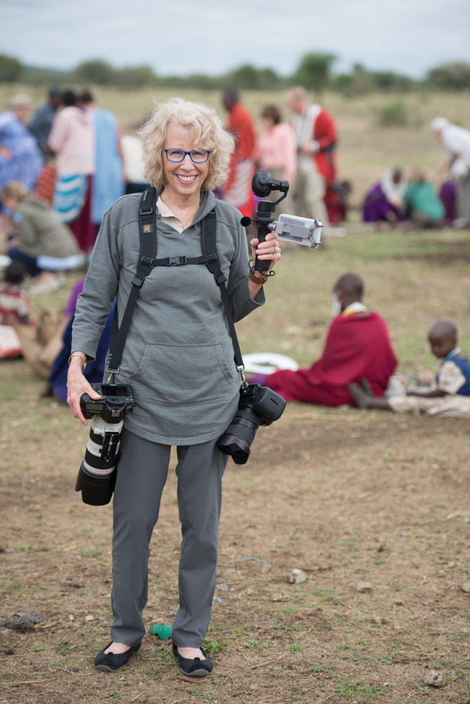 Caroline Maryan in a Masai village with 3 cameras