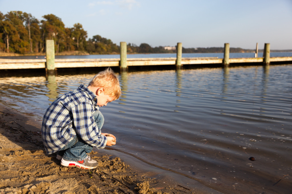 young child playing by the water