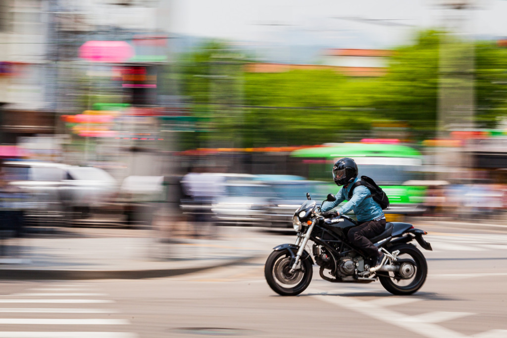 Seoul motorcycle in traffic with motion blur using panning
