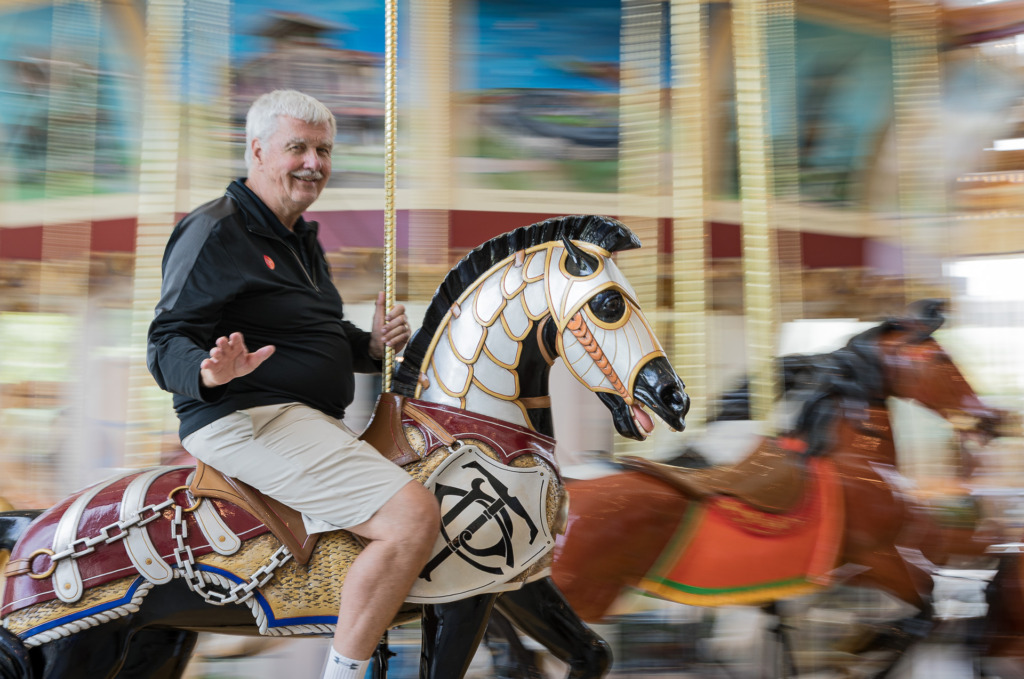 man on carousel with motion blur using panning
