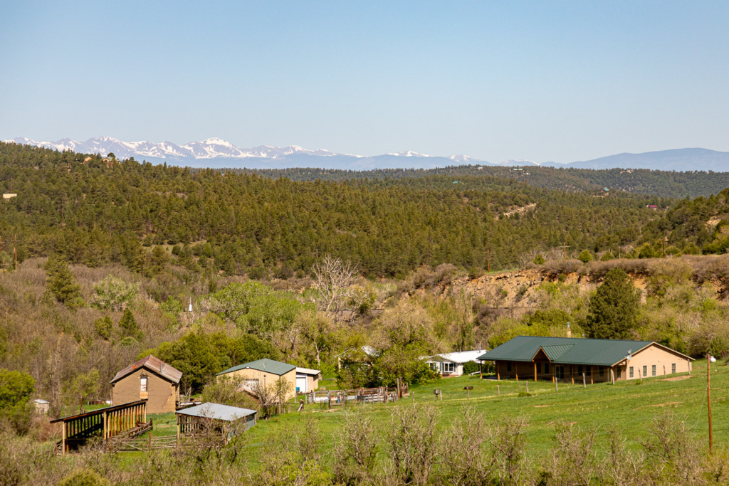 view of a ranch and the Rocky Mountains in Colorado